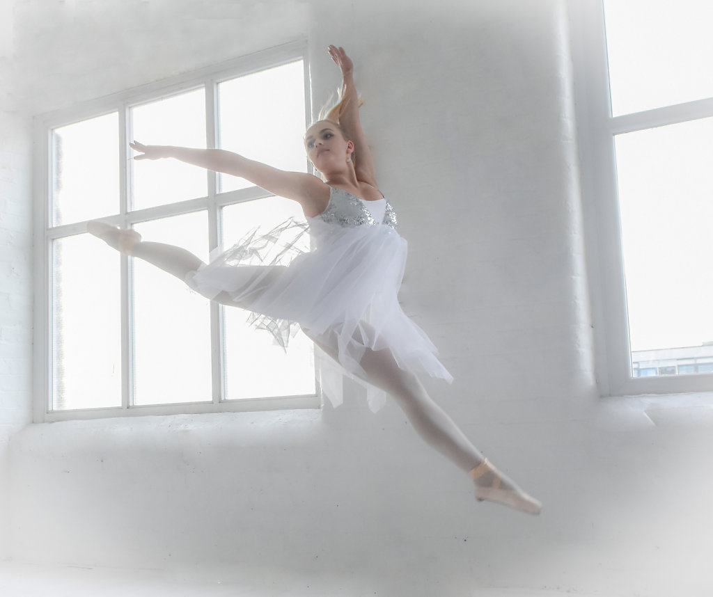 Leaping white dancer