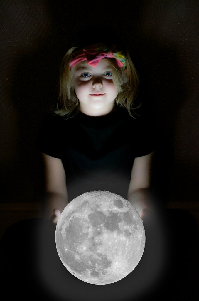 Nicole holding the moon